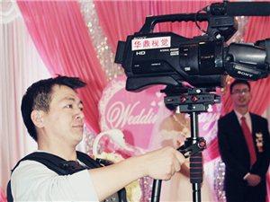王虎周,摄像师